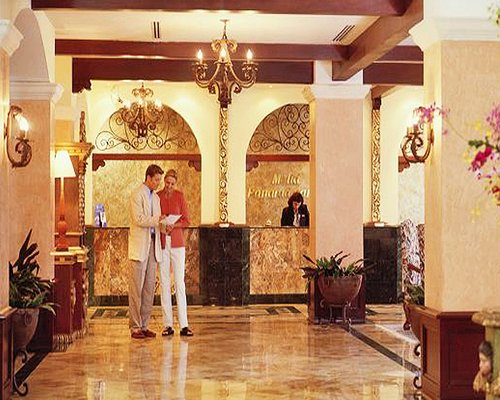 A couple in the reception area of the resort.