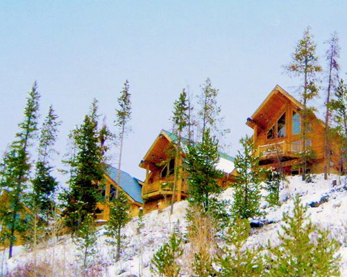 Exterior view of The Cabins at Bear River Lodge coverd in snow.