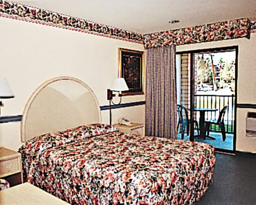 A well furnished bedroom with patio.