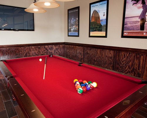 Indoor recreation room with pool table.