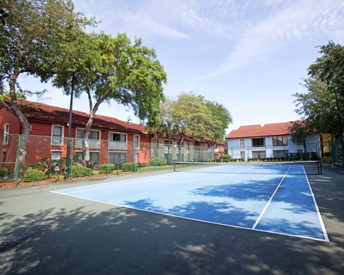 Outdoor tennis court alongside the units.