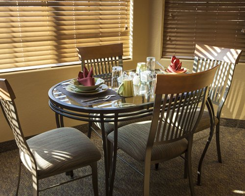 A well equipped dining room with an outside view.