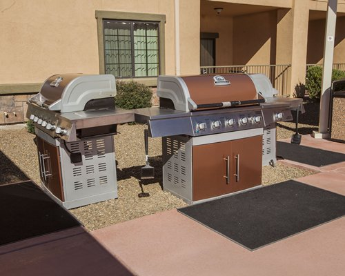 A view of two barbeque grill.