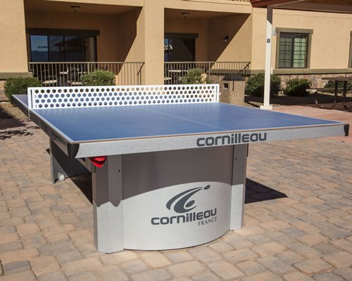 An outdoor recreational area with a ping pong table.