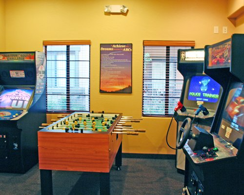 Indoor recreation room with arcade games and foosball.