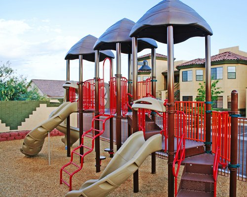 An outdoor kids playscape with slides.