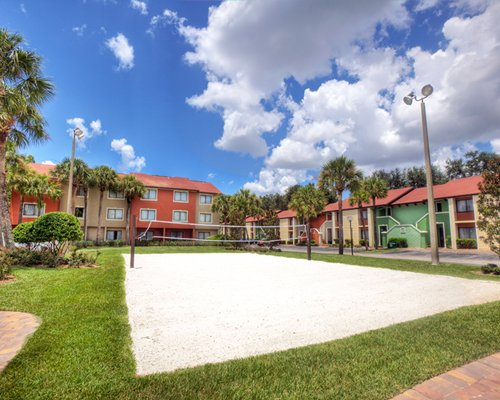 Exterior view of Legacy Vacation Club Orlando Resort World with outdoor tennis court.