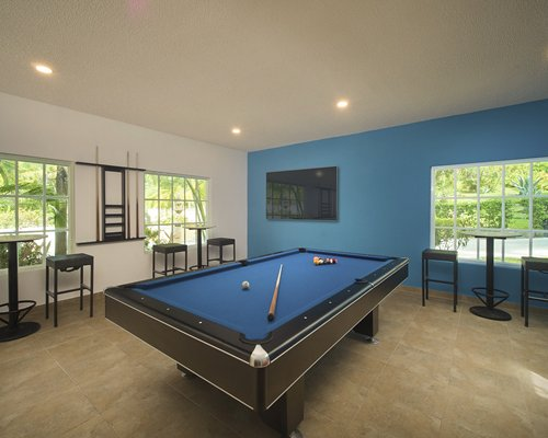 A well equipped indoor sports center with pool table.