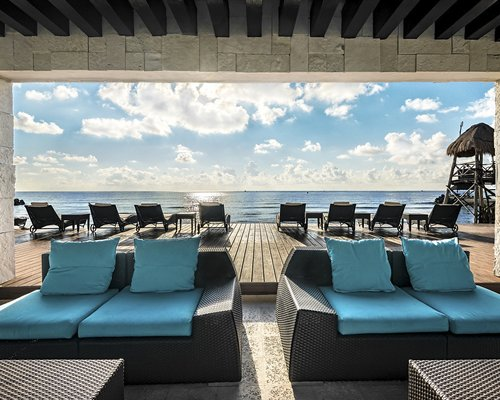 A lounge with view of ocean.