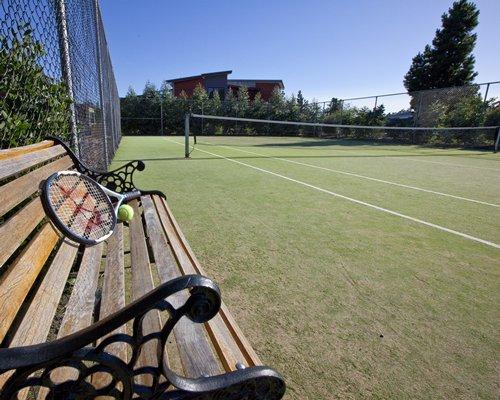 A view of an outdoor tennis court.