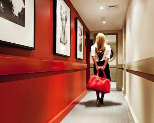 A woman walking through a corridor.