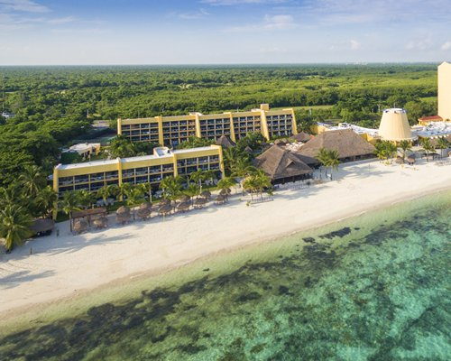 Exterior view of Club Melia At Melia Cozumel alongside the beach.