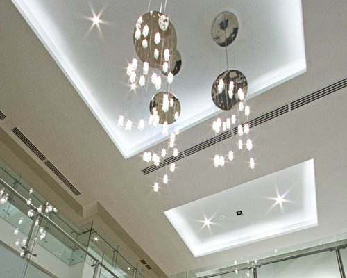 Interior view of indoor balcony and ceiling with lights.