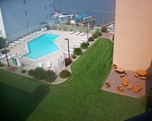 Scenic aerial view of the outdoor swimming pool with chaise lounge chairs and patio furniture.