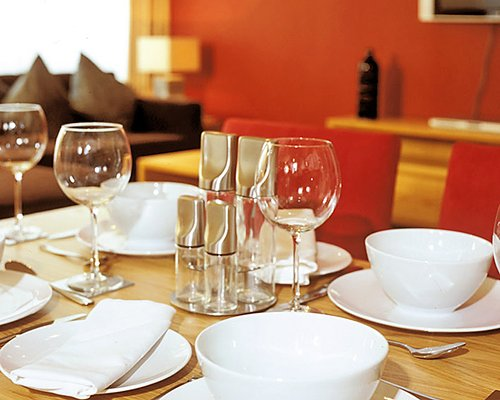 A view of plates and glasses on a table.