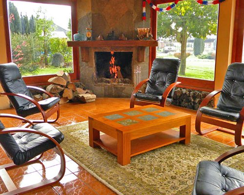 A well furnished living room with a fireplace and outside view.