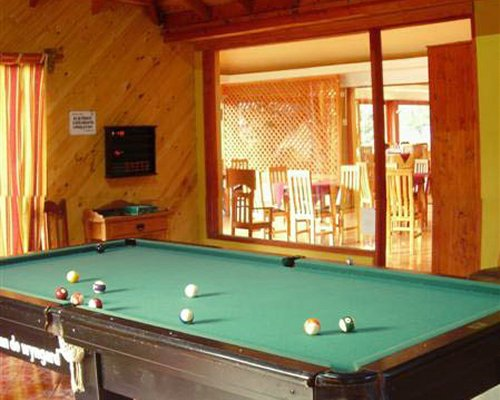 An indoor recreational room with a pool table.