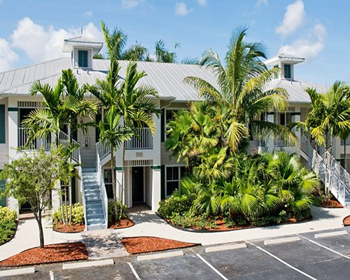 Street view of the resort units with trees and shrubs.