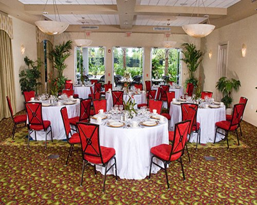 An indoor fine dining area at the Greenlinks Golf Resort with an outside view.