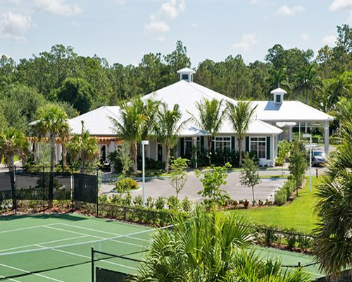 Scenic exterior view of the resort alongside the tennis court.