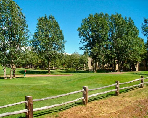 Scenic exterior view of the golf course with wooden fencing.