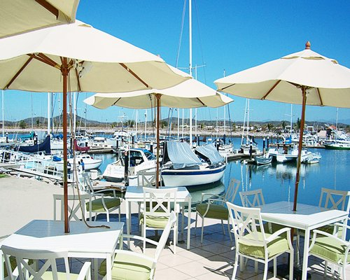 An outdoor dining area alongside marina.