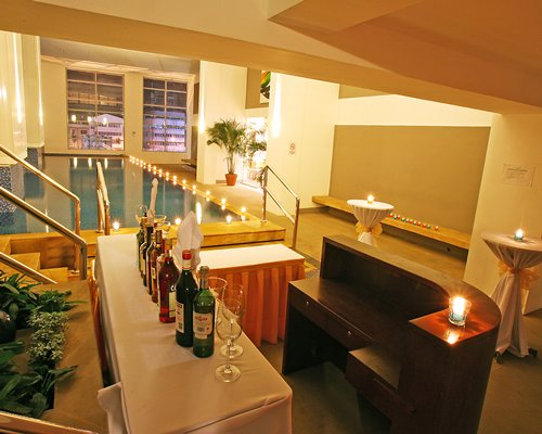 A well equipped indoor poolside bar.