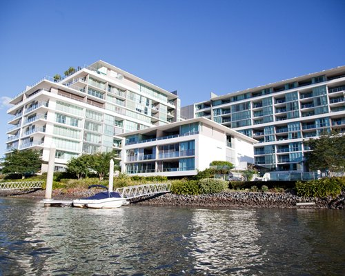 An exterior view of the Ultiqa at Freshwater Point alongside the waterfront.