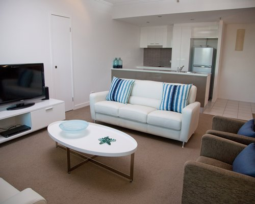 An open plan living and kitchen area with a television.
