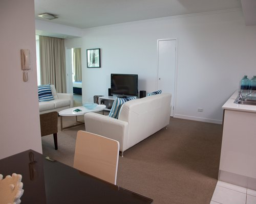 An open plan living and dining area with a television.