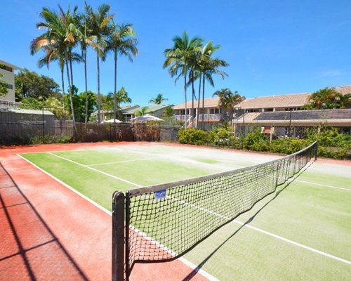 An outdoor tennis court alongside the Noosa Keys Resort.