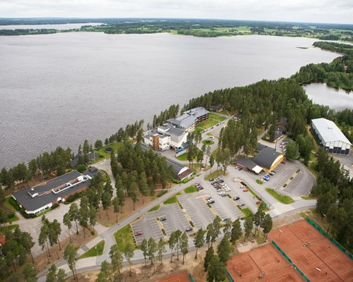 An aerial view of the Holiday Club Kuortane Sports Resort properties alongside the lake.