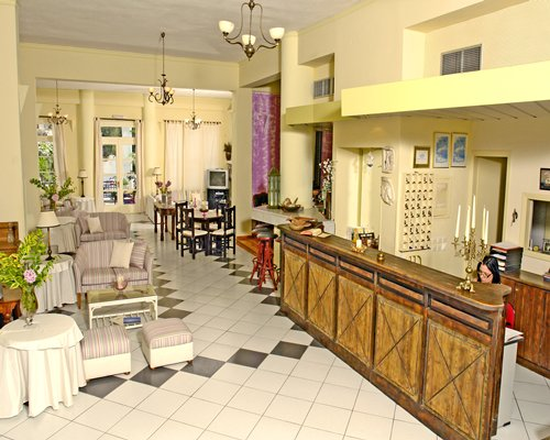 A well furnished reception area with lounge access and a television.