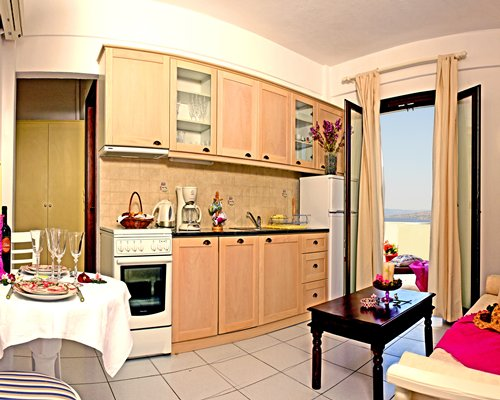 An open plan living dining and kitchen area withy a balcony.