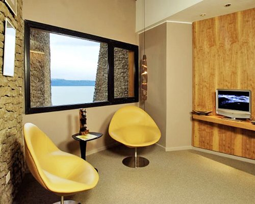 A well furnished indoor room with a television and an outside view.