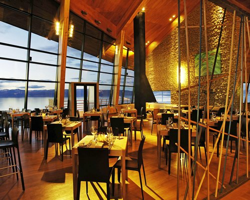 An indoor fine dining restaurant with outside view.