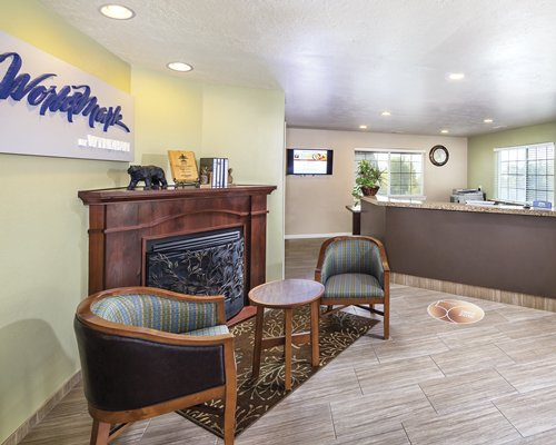 A reception area of WorldMark Midway resort with a fireplace.