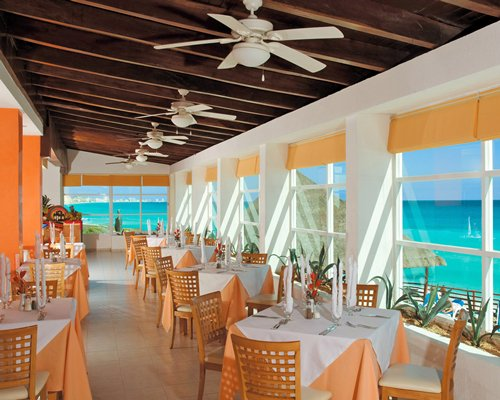 An indoor fine dining restaurant with a view of the sea.