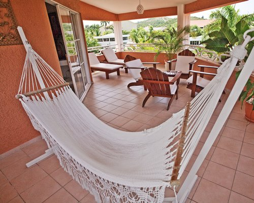 A well furnished indoor lounge area with a hammock.