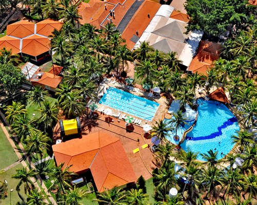 An aerial view of the resort properties surrounded by the coconut trees.