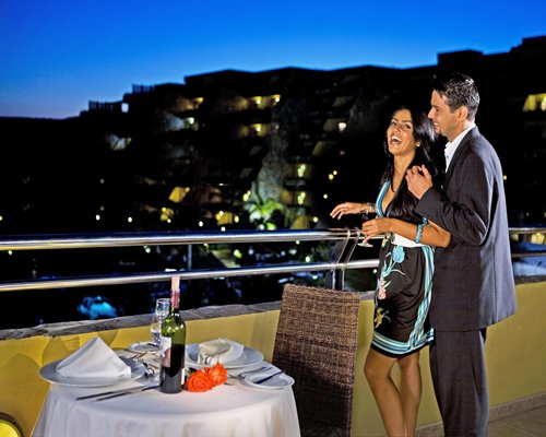 A couple enjoying in a roof top fine dining restaurant.
