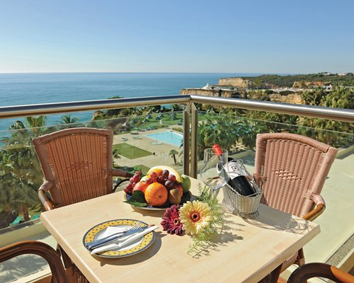 Balcony with fruits on a table and the ocean view.