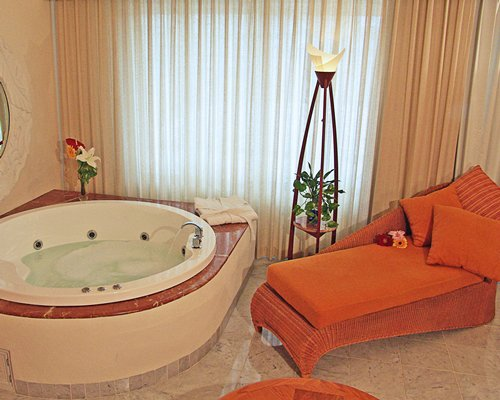 Interior view of a hot tub and chaise lounge sofa.