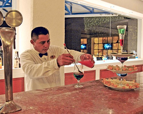 A man preparing cocktail in a restaurant.