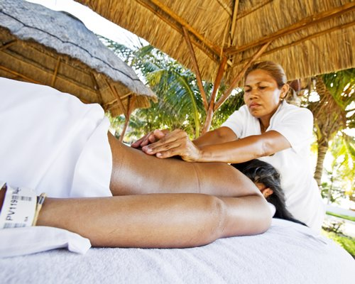 A woman having a massage at the outdoor spa.