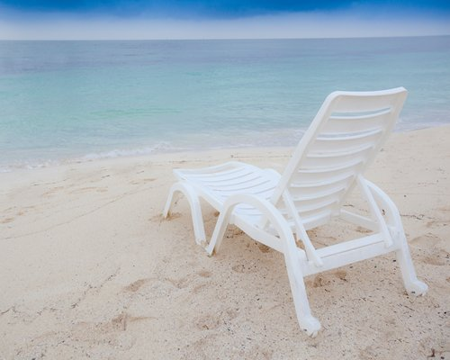 A view of chaise lounge chair facing the beach.