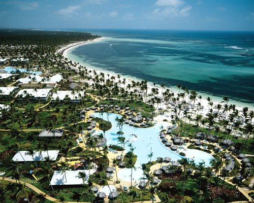 Birds eye view of the resort property alongside the ocean.