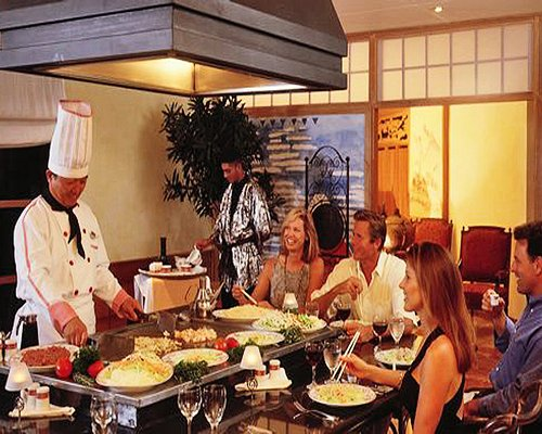 A family dining at an indoor fine dining area of the resort.