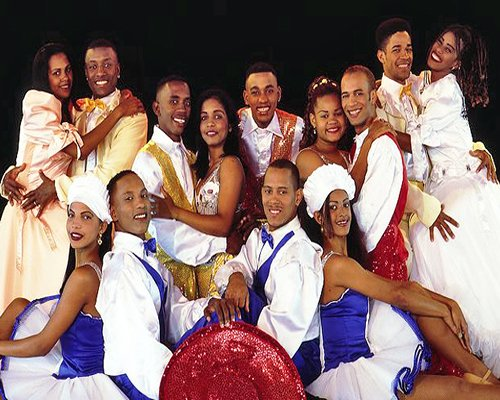 Group of people posing in the dance costume.