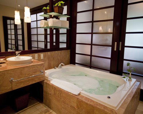 A bathroom with bathtub and sink.